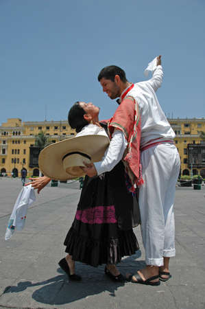 lima: Marinera dancers in front of colonial buildings in Lima Peru Stock Photo