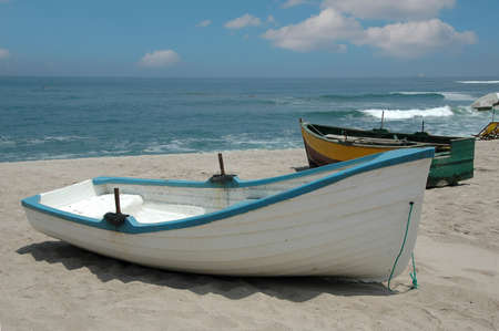 lima: Rustic fishing boast in the coast of Lima Peru on a sunny day Stock Photo