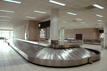 claim: Baggage carrousel at the airport Stock Photo