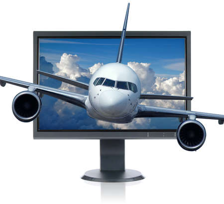 LCD monitor and airplane isolated over a white background Stock Photo