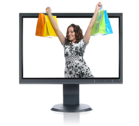 Girl shopping getting out of an LCD monitor isolated over a white background