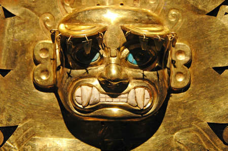 Peruvian ancient mask made out of gold and zaphire 写真素材