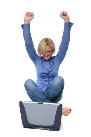 Blond with laptop celebrating isolated on white� Stock Photo