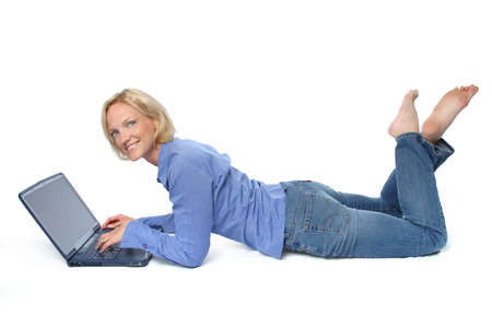 blond with laptop isolated on white background