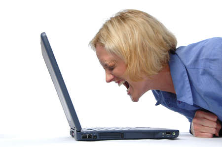 error: Businesswoman screaming at her laptop Stock Photo