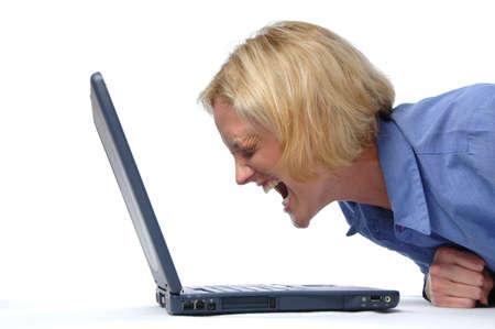 computer crash: Businesswoman screaming at her laptop Stock Photo