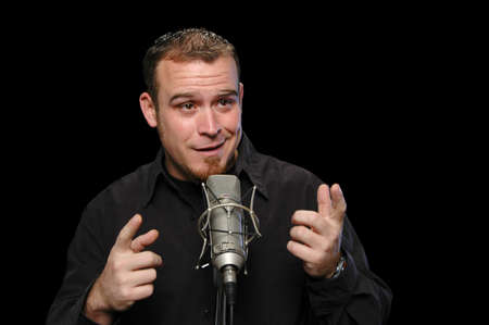 comedian: Comedian performing on a black background Stock Photo