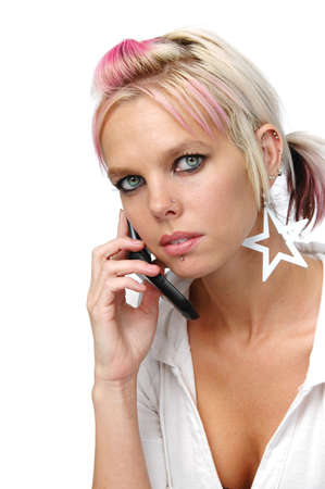 Beautiful blonde with piercings on the cell phone Stock Photo - 7772882
