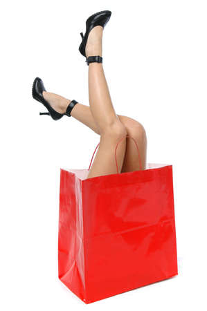Legs with high heels in a shopping bag Stock Photo - 7771603