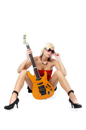 Beautiful blonde pin-up with guitar isolated on white