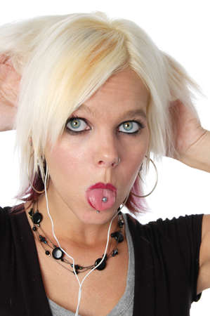 Blond sticking out pierced tongue on a white background photo