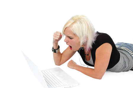 Blond upset at her laptop isolated on white Stock Photo - 7772045