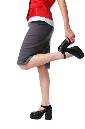 Waist down view of girl wearing high heels isolated on white Stock Photo - 7771825
