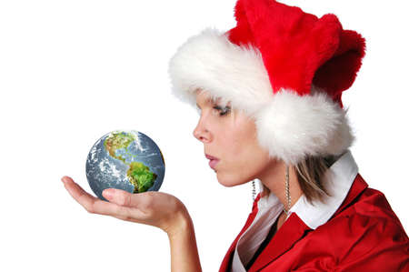 Santa Girl blowing wishes on earth isolated on white photo