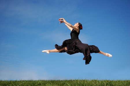 Dancer jumpimp against a blue sky Stock Photo - 7772408