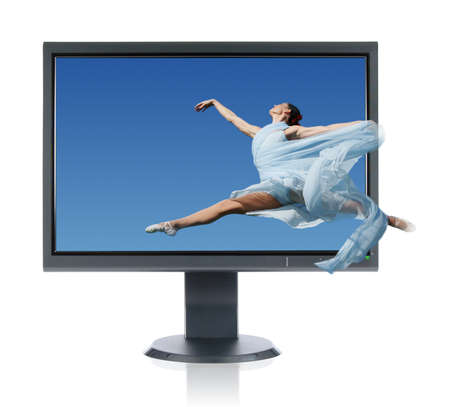 computer dancing: Ballerina jumping into a monitor isolated on a white background