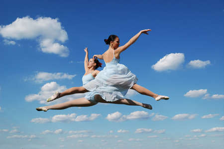 leap: Ballerinas performing outdoors agaist a blue sky