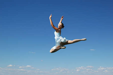 Jumping ballerina on a sunny day photo