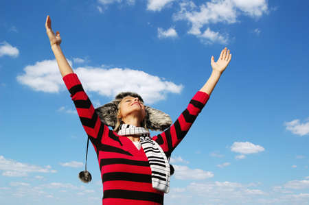 Girl with arms wide open in attitude of worship Stock Photo - 7774179