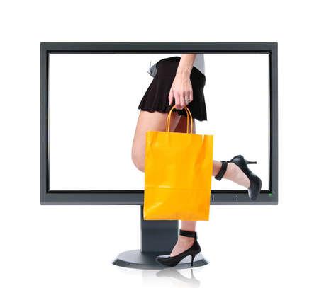 Girl shopping on line wearing high heels photo