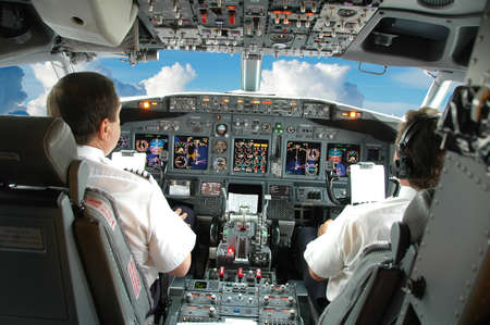 controls: Pilots in the cockpit during a commercial flight