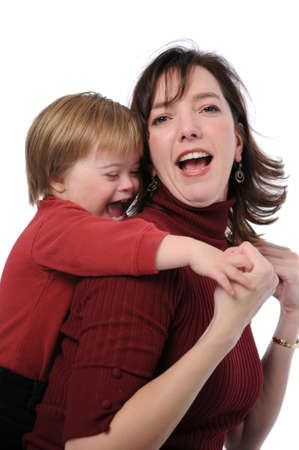 Mother and son with down syndrome playing photo
