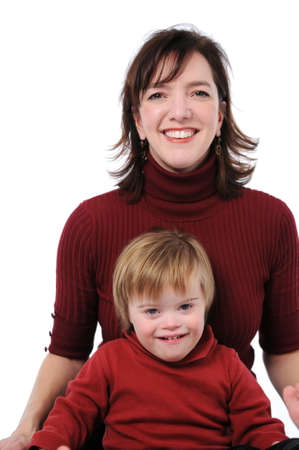 syndrome: Mother and son with down syndrome smiling Stock Photo