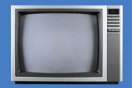 Vintage television isolated on a blue background Stock Photo - 7774261