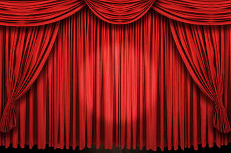 Large red curtain stage with spot light photo