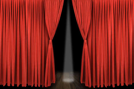 Large red curtain stage opening with dark bakground and spot light