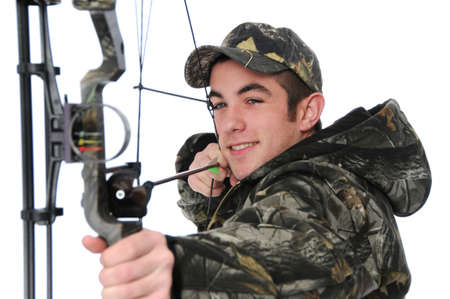 Young hunter with bow aiming isolated on white Stock Photo