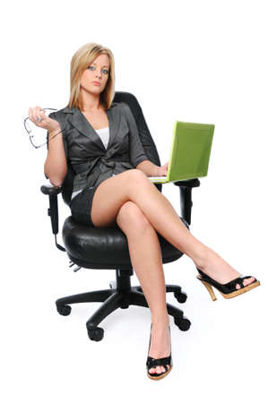 business woman legs: Young businesswoman with laptop sitting on a chair