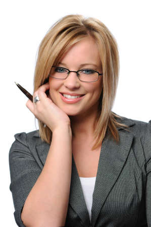 Young businesswoman with glasses holding a pen photo