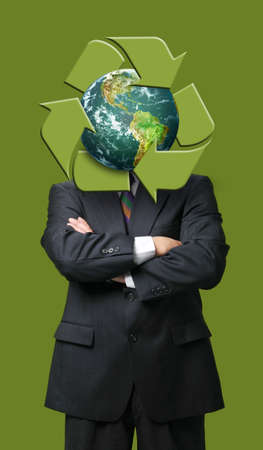 business metaphore: Global recycle business metaphore against a green background Stock Photo