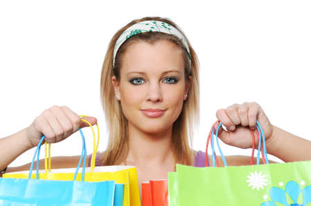 Young girl with shopping bags isilated on white 스톡 콘텐츠