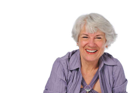 Very attractive Senior lady smiling isolated on white Stock Photo