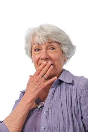 75s: Senior lady showing surprise isolated on white