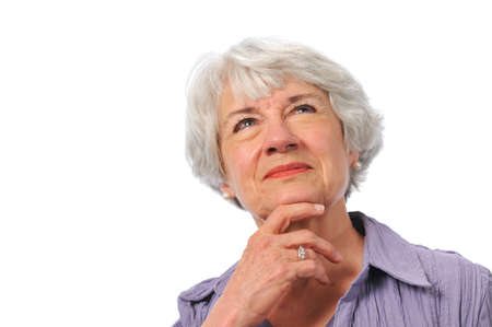 75s: Senior lady looking up and thinking isolated on white