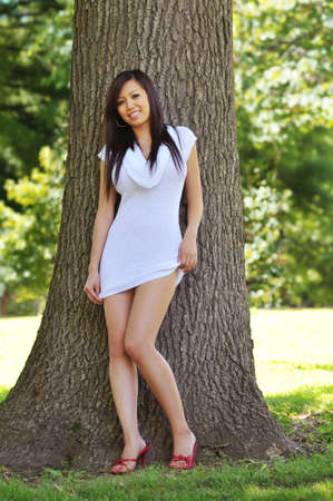 sexy asian woman: Beautiful oriental model posing outside