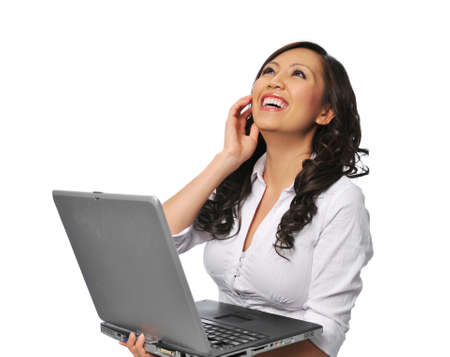 working woman: Young asian woman laughing and holding a laptop isolated on white