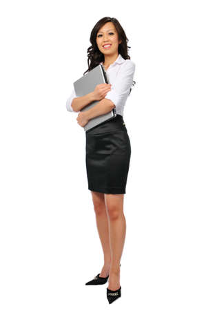 Young businesswoman with laptop isolated on white and standing Stock Photo