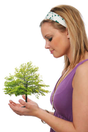 Young woman holding tree isolated on white Stock Photo - 7796816