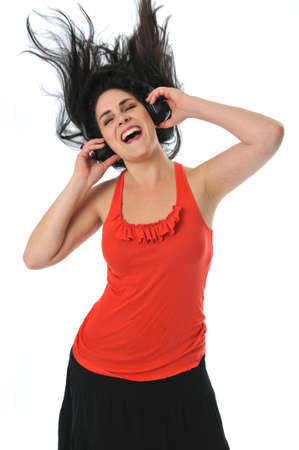 Young woman with headphones dancing isolated on white photo