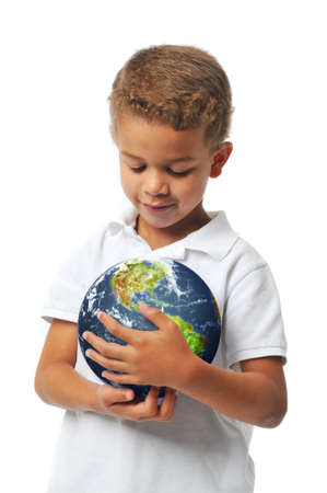 Boy holding the planet earth isolated on white photo