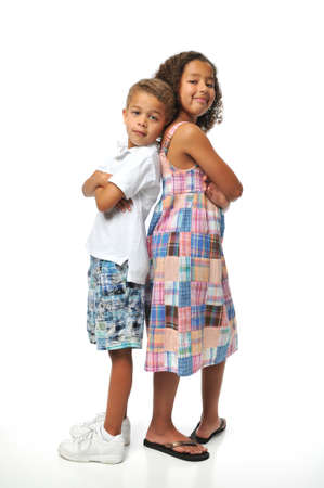 Sister and brother smiling isolated on white Stock Photo