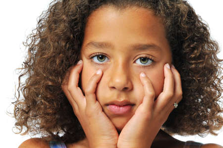 biracial: Portrait of beautiful biracial girl with hands on her face