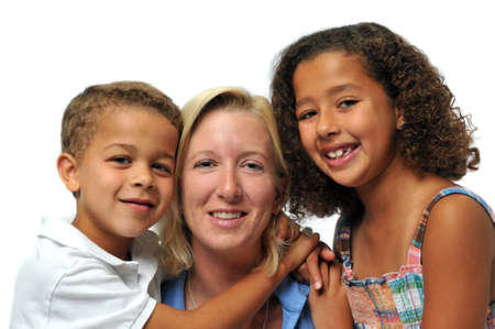 biracial: Portrait of biracial family smiling against a white background Stock Photo