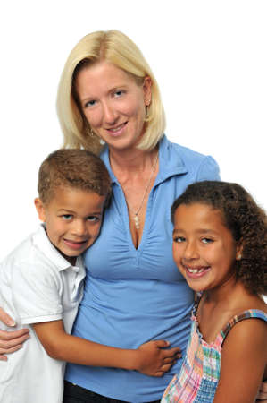 Portrait of biracial family smiling against a white background photo