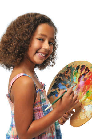 Girl with palette and brush isolated on a white background photo