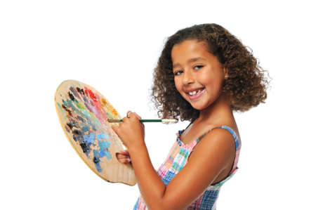 biracial: Girl with palette and brush smiling isolated on a white background